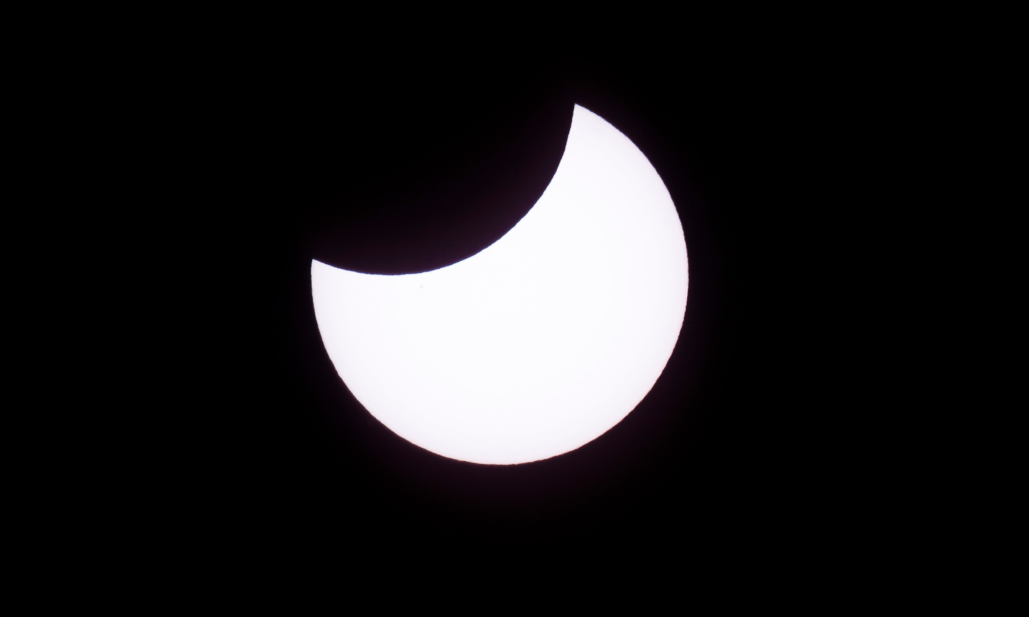 Picture taken on February 26, 2017 showing the moon moving to cover the sun for an annular solar eclipse, as seen from the Estancia El Muster, near Sarmiento, Chubut province, 1600 km south of Buenos Aires, Argentina, on February 26, 2017.  Stargazers applauded as they were plunged into darkness Sunday when the moon passed in front of the sun in a spectacular 'ring of fire' eclipse. / AFP / ALEJANDRO PAGNI        (Photo credit should read ALEJANDRO PAGNI/AFP/Getty Images)
