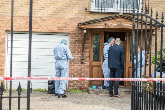 Police forensics at the home where the teenager's body was