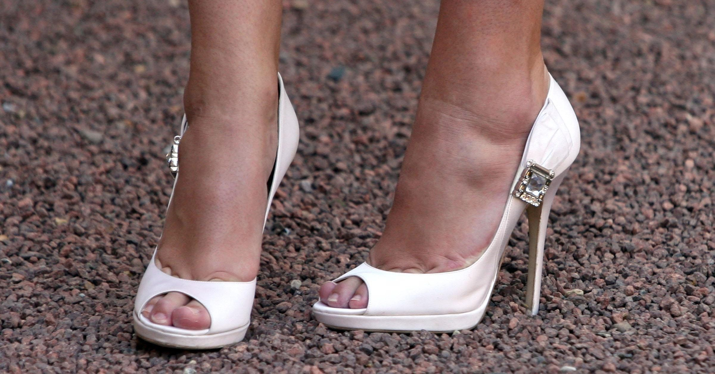 A close-up view of the Jimmy Choo shoes worn by Double Olympic champion Rebecca Adlington as she received her OBE from Queen Elizabeth II during investitures at Buckingham Palace.