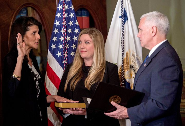 U.S. Vice President Mike Pence (right) swears in Nikki Haley as US ambassador to the United Nations at the Eisenhower Ex