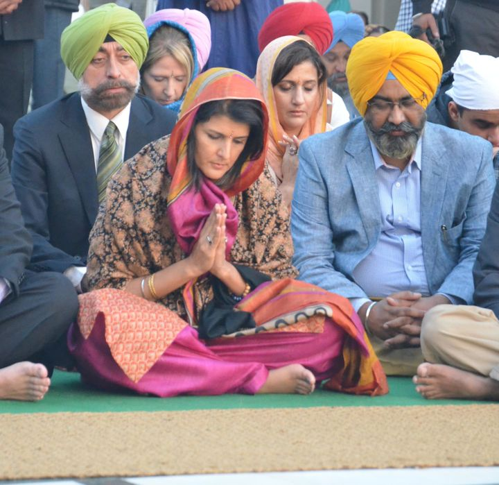 Nikki Haley, who was brought up in the Sikh tradition but now identifies as Christian, pays obeisance at the Golden Temp