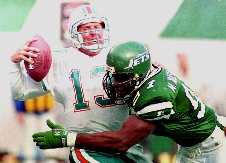 In this file photo from November 1992, New York Jets player Marvin Washington sacks Miami Dolphins quarterback Dan
