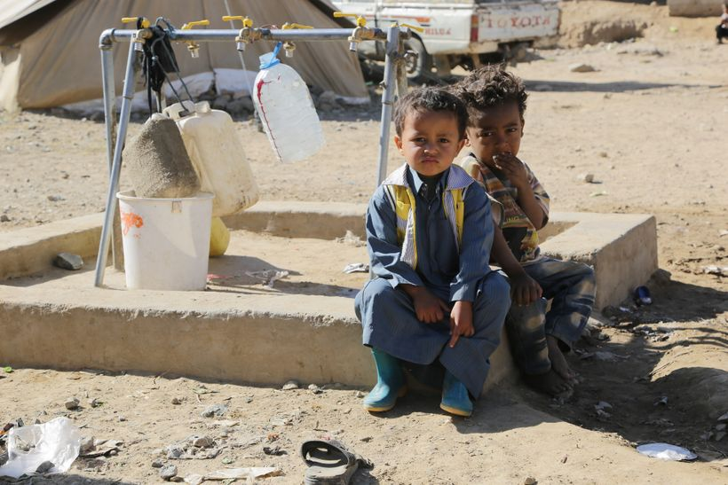 Sultan, 3 years old and Sabir 3 years old sitting by a tap stand in the Huth camp for displaced people in Yemen. Oxfam has be