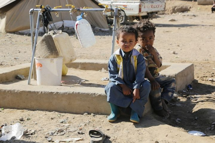 Sultan*, 3 years old and Sabir*, 3 years old sitting by a tap stand in the  Huth camp for displaced people in Yemen. Oxfam ha