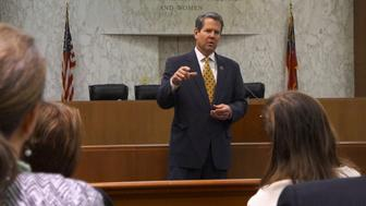 """Georgia Secretary of State Brian Kemp speaks with visitors to the state capitol about the """"SEC primary"""" involving a group of southern states voting next month in Atlanta, Georgia February 24, 2016. Candidates have campaigned more in the South this election year in an effort to woo a group of states voting early on so-called Super Tuesday than Kemp can recall seeing in any contemporary primary. And the seven states holding contests in the region appear poised to play a pivotal role in selecting the Republican and Democratic nominees for the November 8 race. Picture taken February 24, 2016. REUTERS/Letitia Stein"""