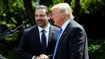 U.S. President Donald Trump (R) shakes hands  with Lebanese Prime Minister Saad Hariri after their meeting at the White House in Washington, U.S., July 25, 2017. REUTERS/Yuri Gripas