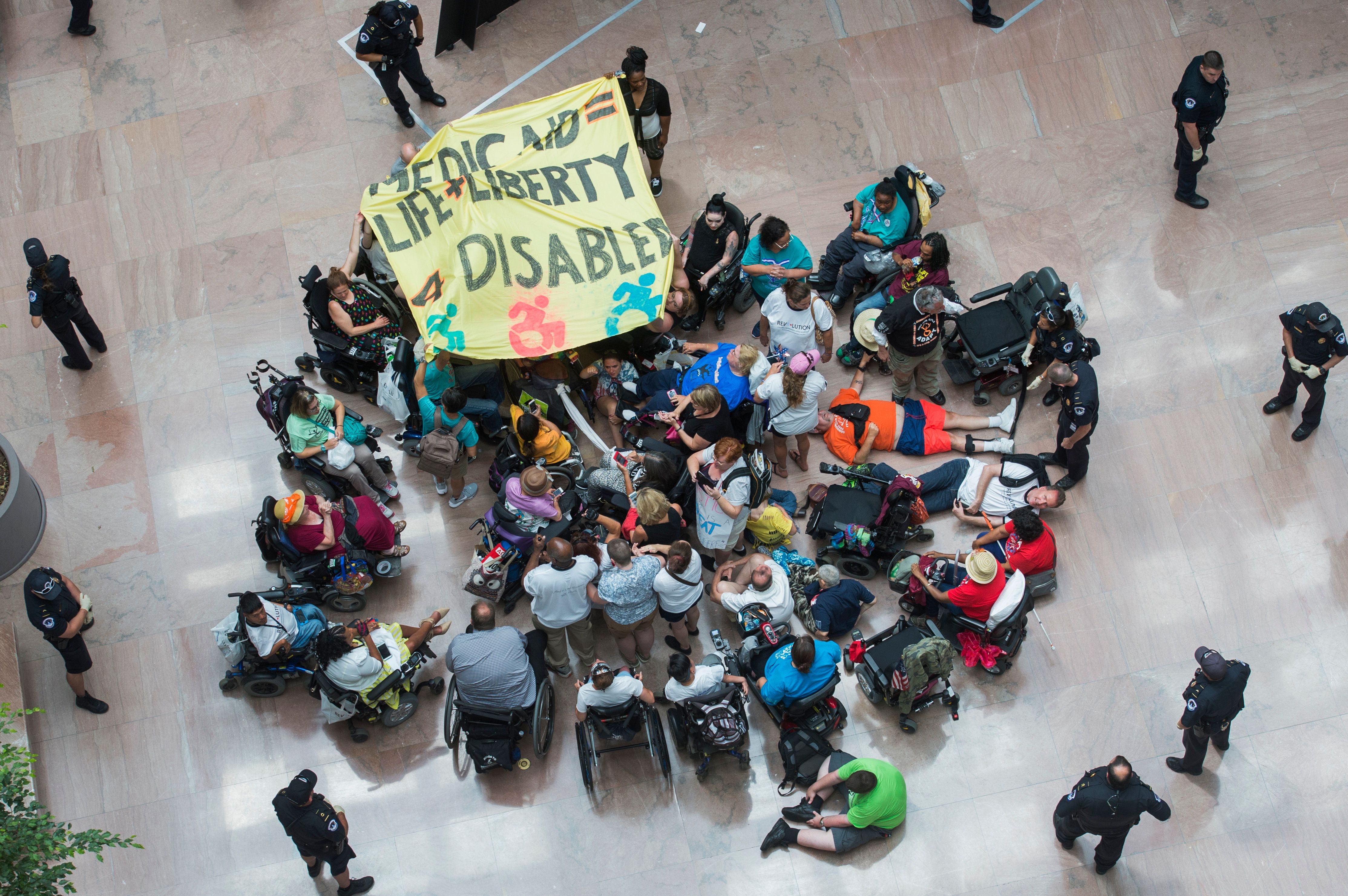 UNITED STATES - JULY 25: Demonstrators gather in the atrium of Hart Building to protest the Senate's health care bill on July 25, 2017. (Photo By Tom Williams/CQ Roll Call)