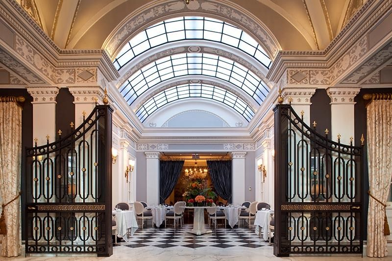 Dramatic skylight brightens dining at the Jefferson's Greenhouse restaurant.
