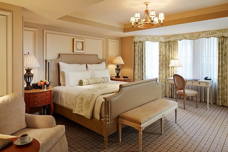 A deluxe king guest room features bow window with spacious footprint and artful design.