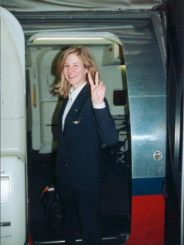 Christine as a flight attendant.
