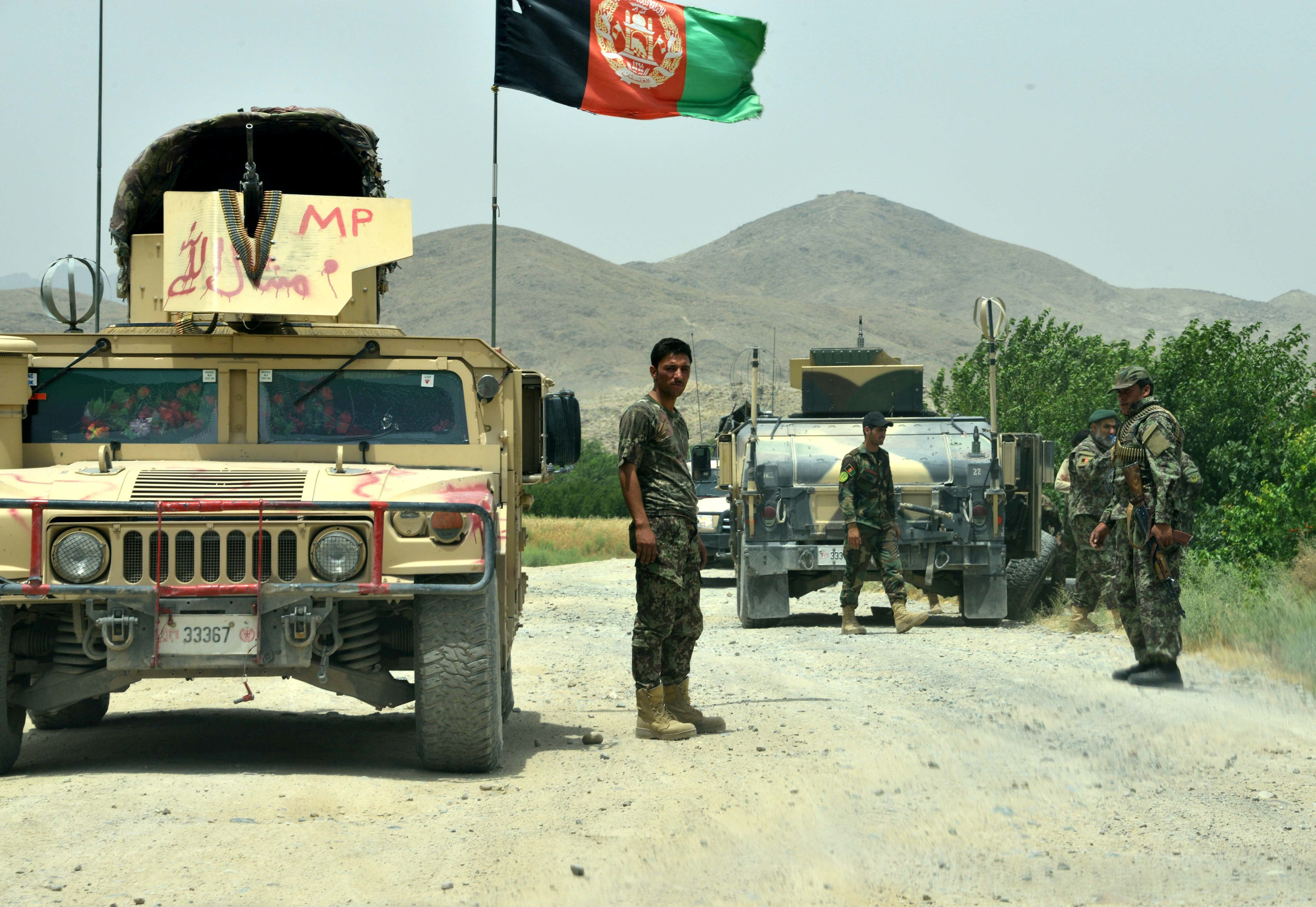 Afghan National Army (ANA) soldiers patrol the Shah Wali Kot district of Kandahar province on May 23, 2017. At least 10 Afghan soldiers were killed when militants attacked their army base in the southern province of Kandahar, the defence ministry said May 23, in the latest attack on Western-backed forces. / AFP PHOTO / JAVED TANVEER        (Photo credit should read JAVED TANVEER/AFP/Getty Images)