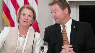 WASHINGTON, DC - JULY 19: (AFP OUT) Sen. Shelley Moore Capito (R-WV) (L) and Sen. Dean Heller (R-NV) (R) speak with one another before the start of a lunch with members of Congress hosted by US President Donald J. Trump (not pictured) in the State Dining Room of the White House on July 19, 2017 in Washington, DC. (Photo by Michael Reynolds - Pool/Getty Images)