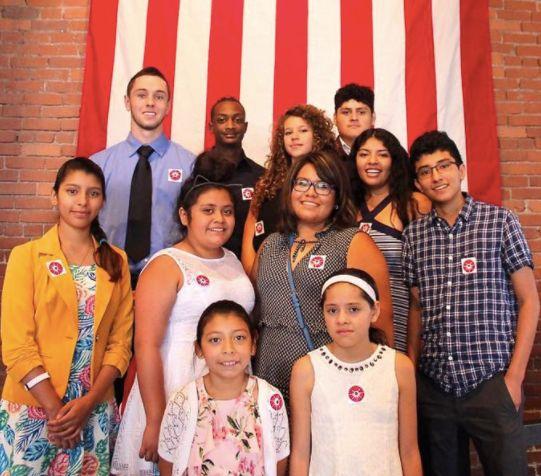 Casa San Jose community members celebratea naturalization ceremony at the Heinz History Centerthis