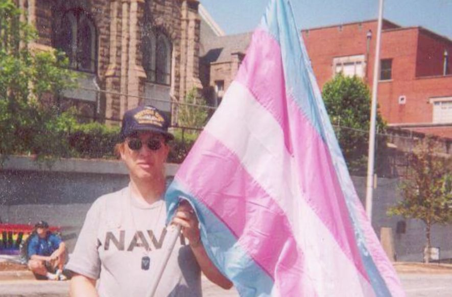 Monica Helms holding the original trans pride flag that she created in