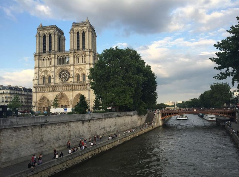 Walking along the Seine and ran into Notre Dame. Location: Paris, France