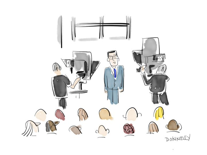 Colbert with cameras and audience.