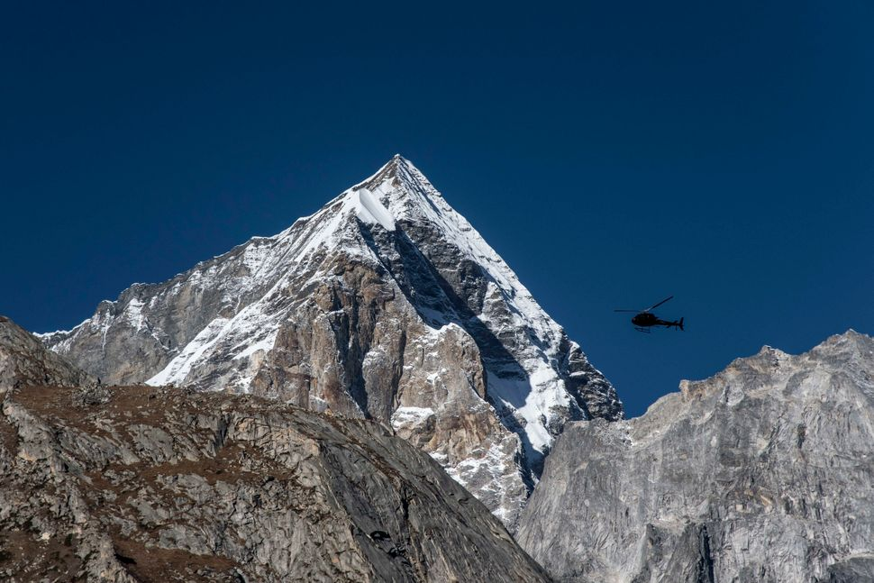 An Indian Army helicopter flies over a peak in the Western Himalayas. Oct. 12, 2016.