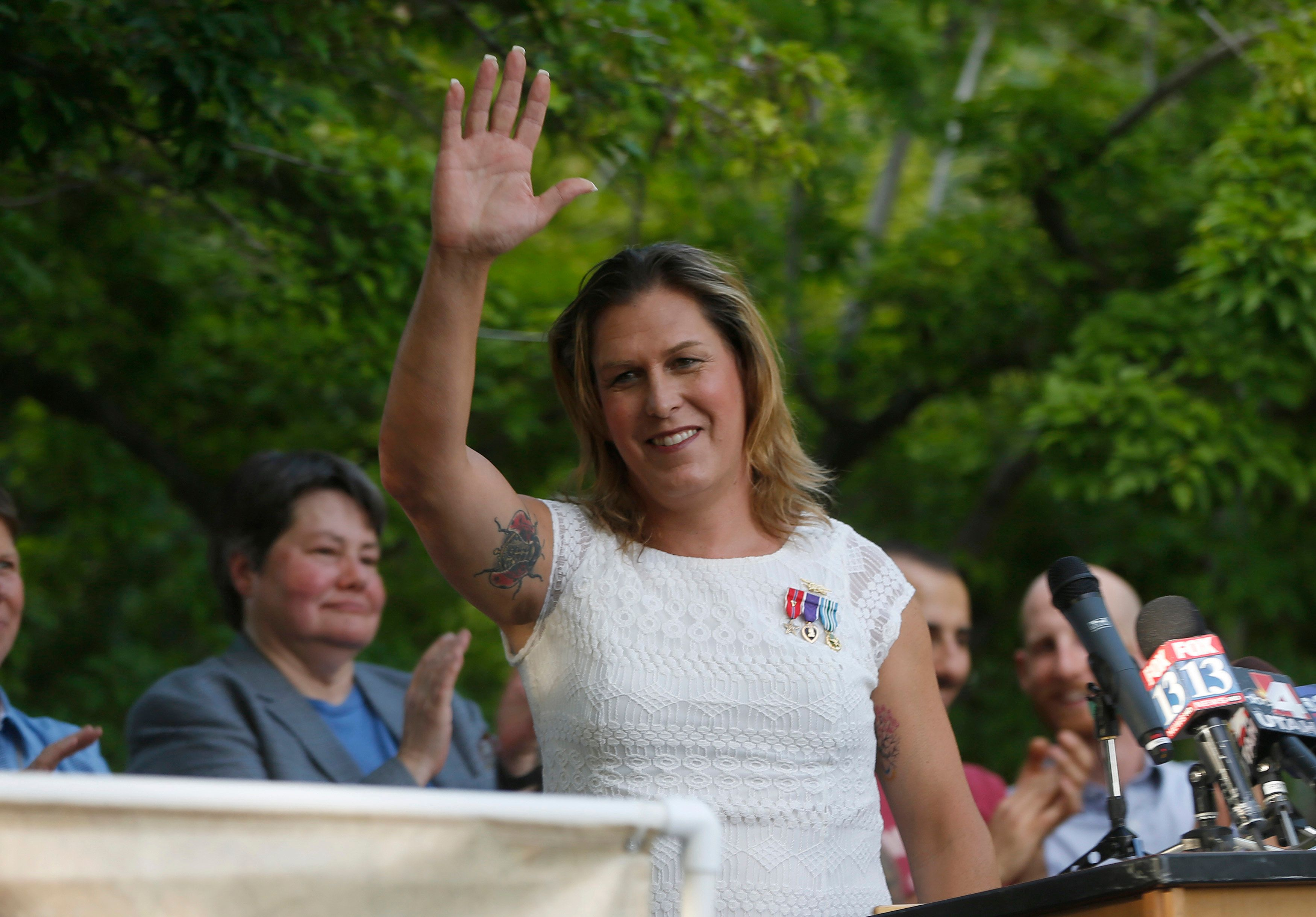 Kristin Beck, a former U.S. Navy SEAL, speaks during a same-sex marriage rally to celebrate the 10th Circuit Court of Appeals decision in Salt Lake City, Utah, June 25, 2014. The U.S. appeals court ruled on Wednesday that conservative Utah may not ban gay couples from marrying, a decision that capped a day of victories for same-sex nuptials and nudges the issue closer to the U.S. Supreme Court. REUTERS/Jim Urquhart (UNITED STATES - Tags: POLITICS SOCIETY MILITARY)