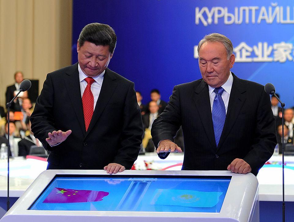 Xi Jinping and Nursultan Nazarbayev, the president of Kazakhstan, at a ceremony celebrating economic...