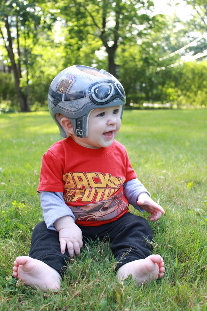"Emily and Justin Davis' son, Brendan, has a head-shaping helmet ""Back to the Future"" fans will love."