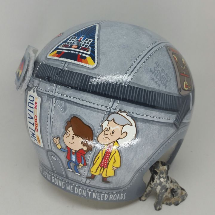 The helmet includes this fun cartoon of Marty McFly and Doc.