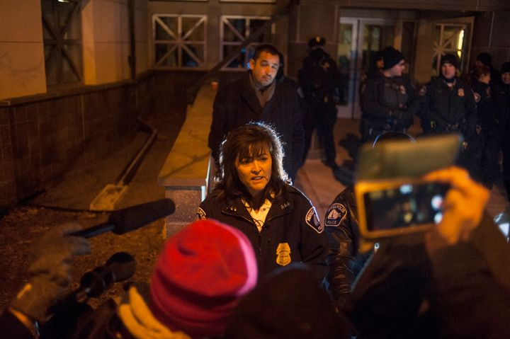 Minneapolis Police Chief Janee Harteau speaks with protesters behind a barricade outside Nov. 20, 2015, over the shooting dea