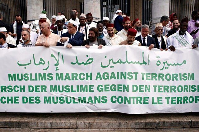 Participants of the Muslim March Against Terrorism demonstration pay tribute to the victims of terrorism in Brussels, Belgium