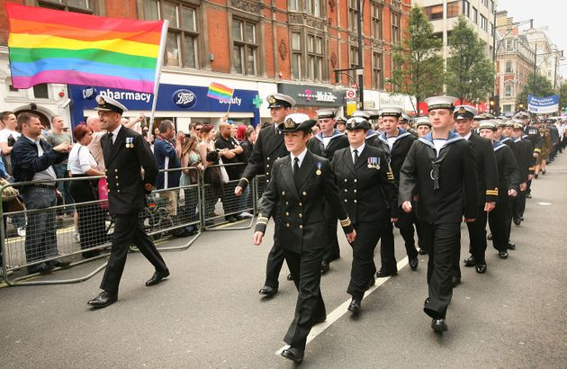 Military personnel take part in the Pride
