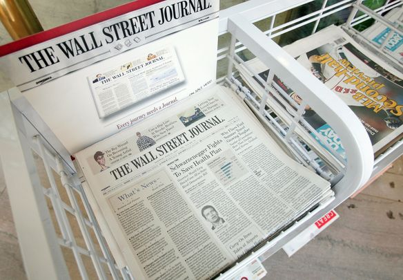 CHICAGO - JULY 17:  The Wall Street Journal newspaper is offered for sale alongside other papers at a newsstand in the Chicago Board of Trade building July 17, 2007 in Chicago, Illinois. Rupert Murdoch's News Corp. has made a $5 billion offer to purchase Dow Jones & Co., publisher of The Wall Street Journal.  (Photo by Scott Olson/Getty Images)