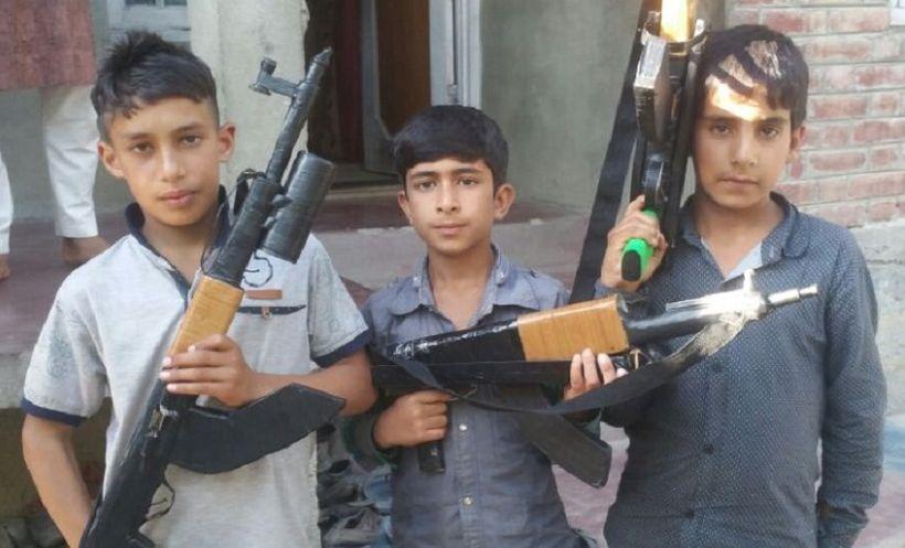 Kashmiri Children with toy guns in their hands.