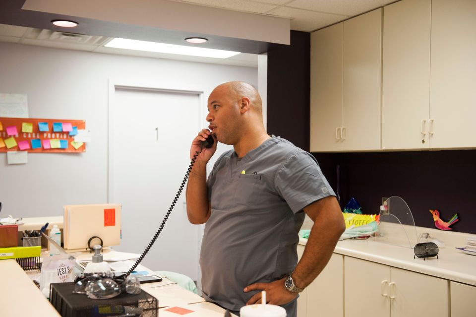 Dalton Johnson, who owns the Huntsville clinic, takes a call from a prospective client and explains the...