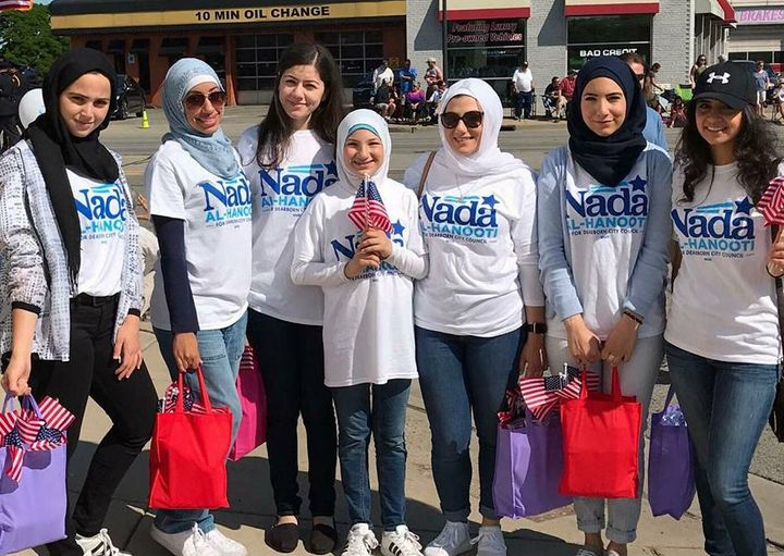LaunchProgress-endorsed candidate Nada Al-Hanooti with supporters at her town's Memorial Day parade.