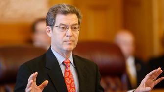 Kansas Gov. Sam Brownback addresses a joint caucus of the state Senate and House Republicans on Thursday, June 11, 2015, stressing the importance of resolving the state's $400 million budget shortfall, at the 'Old Supreme Court' in Topeka, Kan. (Bo Rader/Wichita Eagle/TNS via Getty Images)