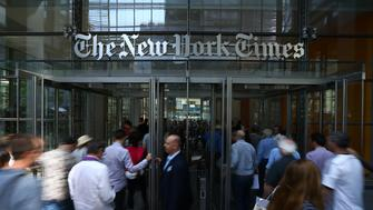 NEW YORK, USA - JUNE 29 : People enter the New York Times (NYT) building in New York, United States on June 29, 2017. NYT employees start a temporary strike against downsizing and dismissal plans of the NYT management. (Photo by Volkan Furuncu/Anadolu Agency/Getty Images)
