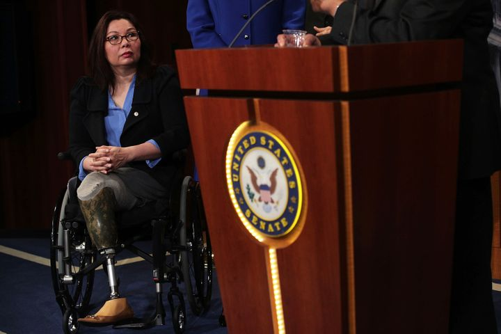 Sen. Duckworth listens during a news conference on April 27, 2017.