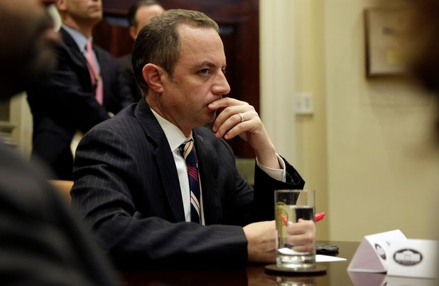 Former White House chief of staff Reince Priebus listens as President Donald Trump meets with Republican...
