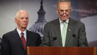 WASHINGTON, DC - JULY 24:  U.S. Sen. Benjamin Cardin (D-MD) (L) and Sen. Charles Schumer (D-NY) (R) participate in a news conference July 24, 2014 on Capitol Hill in Washington, DC. The senators held a news conference to discuss the conflict between Israel and Hamas.  (Photo by Alex Wong/Getty Images)