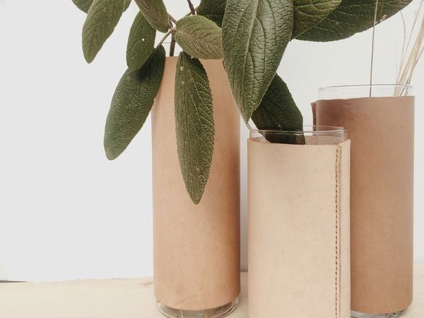 """This glass cylinder wrapped in vegetable tan leather and hand saddle stitched with fine waxed linen thread is the perfect ad"