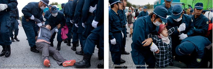 Okinawan protesters being removed by police.