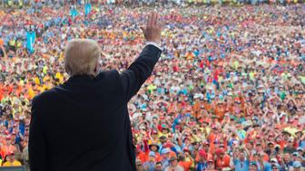 US President Donald Trump waves after speaking to Boy Scouts during the National Boy Scout Jamboree at Summit Bechtel National Scout Reserve in Glen Jean, West Virginia, July 24, 2017. / AFP PHOTO / SAUL LOEB        (Photo credit should read SAUL LOEB/AFP/Getty Images)