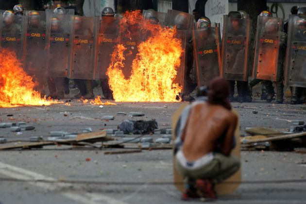 Demonstrators clash with riot security forces at a rally in Caracas, Venezuela, on July