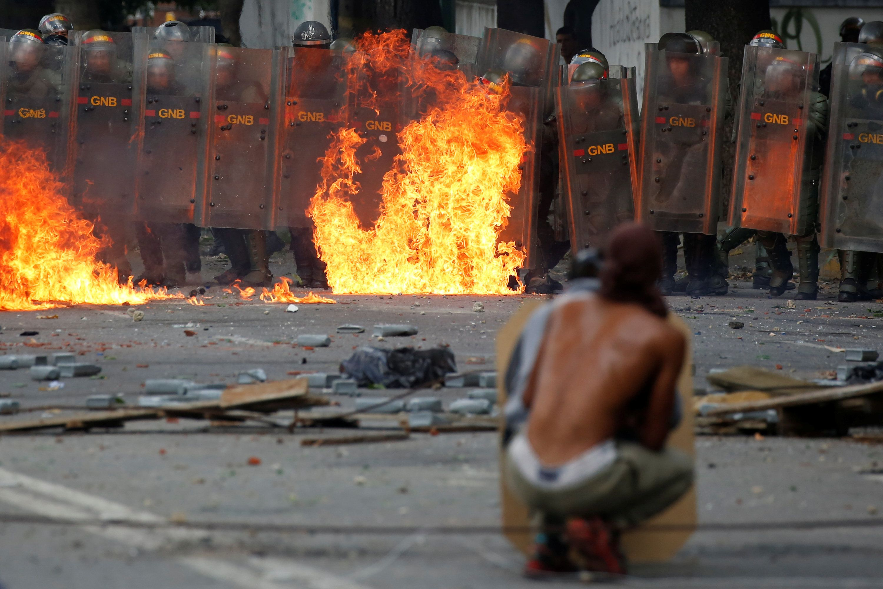Demonstrators clash with riot security forces at a rally in Caracas, Venezuela, on July 26.