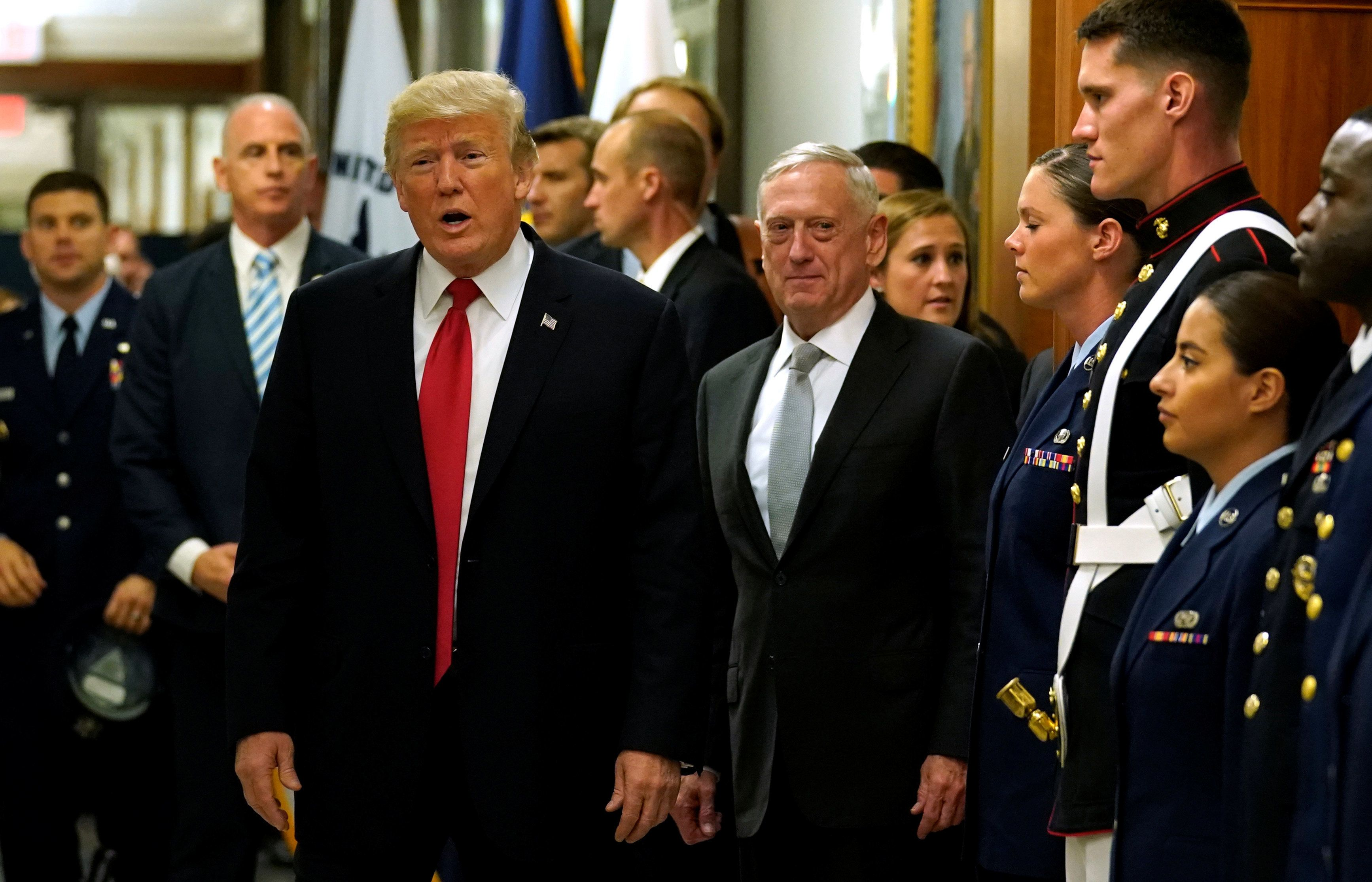 Secretary of Defense James Mattis, right, escorts President Donald Trump as he greets military personnel after attending a me