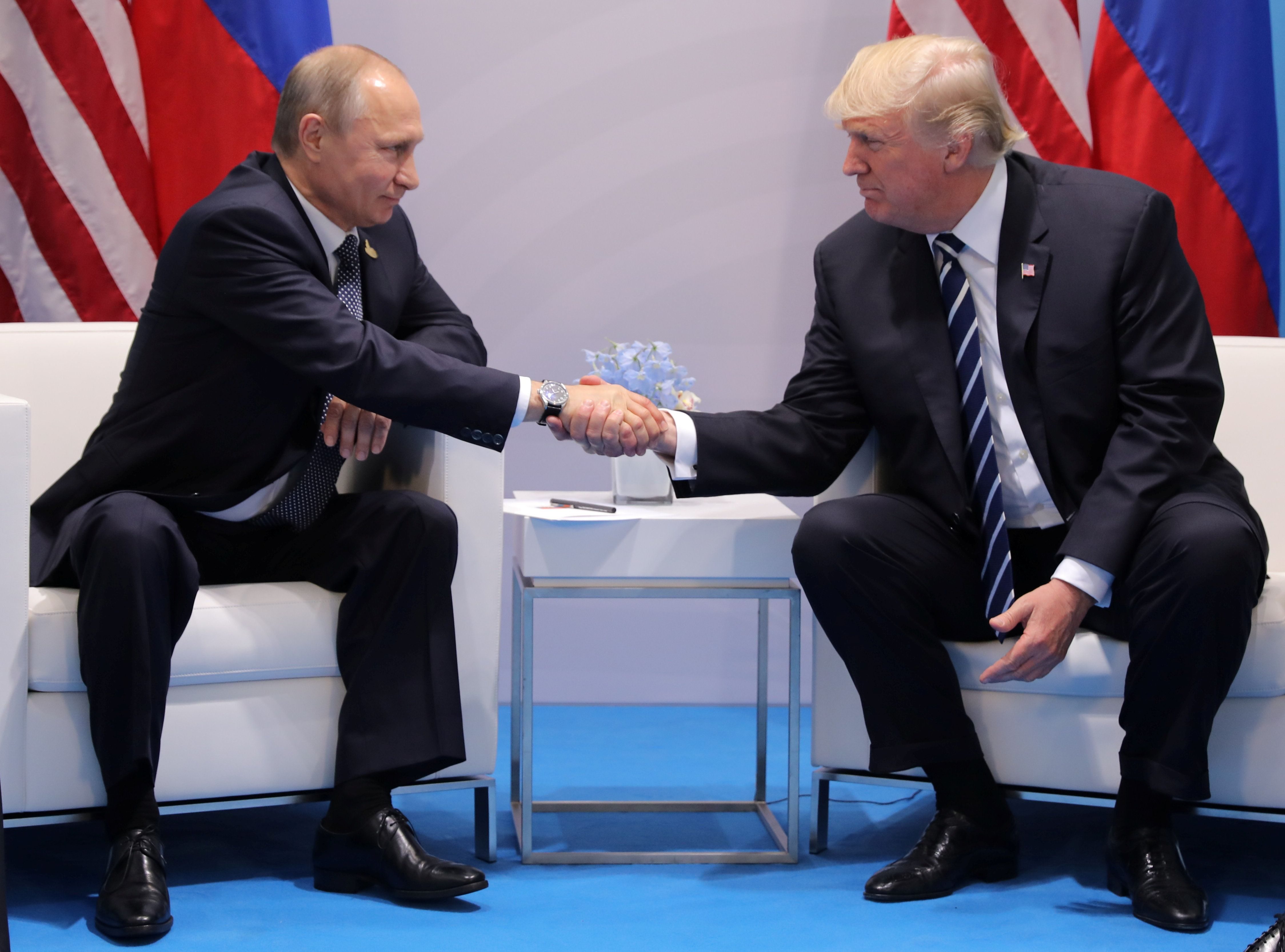 U.S. President Donald Trump shakes hands with Russia's President Vladimir Putin during their bilateral meeting at the G20 summit in Hamburg, Germany July 7, 2017.    REUTERS/Carlos Barria