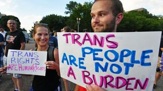 Protesters gather in front of the White House on July 26, 2017, in Washington, DC. Trump announced on July 26 that transgender people may not serve 'in any capacity' in the US military, citing the 'tremendous medical costs and disruption' their presence would cause. / AFP PHOTO / PAUL J. RICHARDS        (Photo credit should read PAUL J. RICHARDS/AFP/Getty Images)