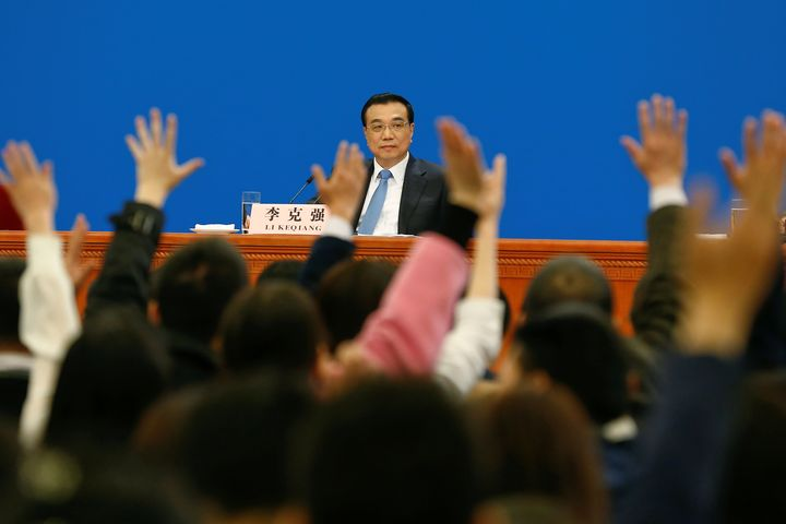China's Premier Li Keqiang speaks with reporters after the closing ceremony of last year's Congress.