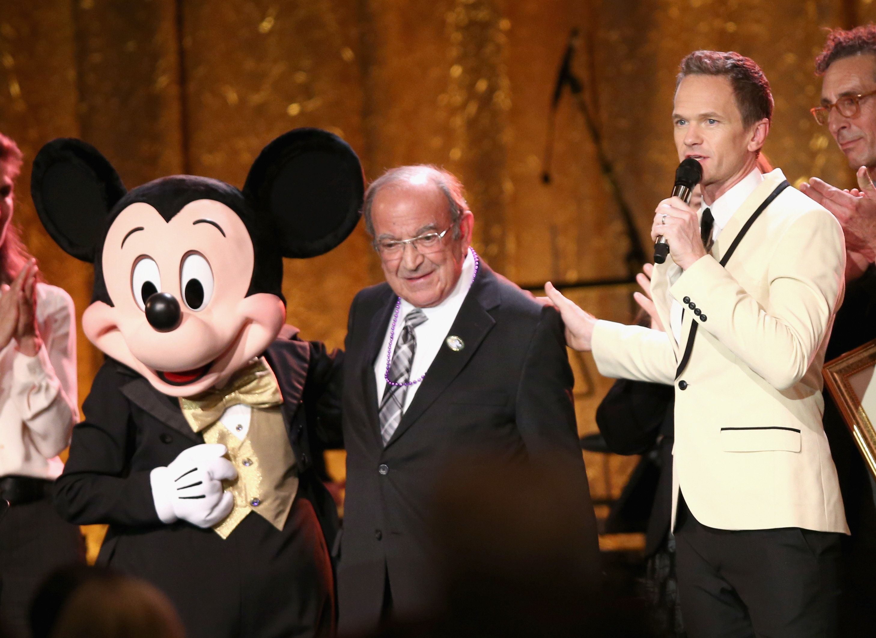 ANAHEIM, CA - NOVEMBER 01:  Recipient of Diane Disney Miller Lifetime Achievement Award, Marty Sklar (L) and Master of Ceremonies, Neil Patrick Harris speak onstage at The Walt Disney Family Museum's 2nd Annual Gala at Disney's Grand Californian Hotel & Spa at The Disneyland Resort on November 1, 2016 in Anaheim, California.  (Photo by Joe Scarnici/Getty Images for The Walt Disney Family Museum)