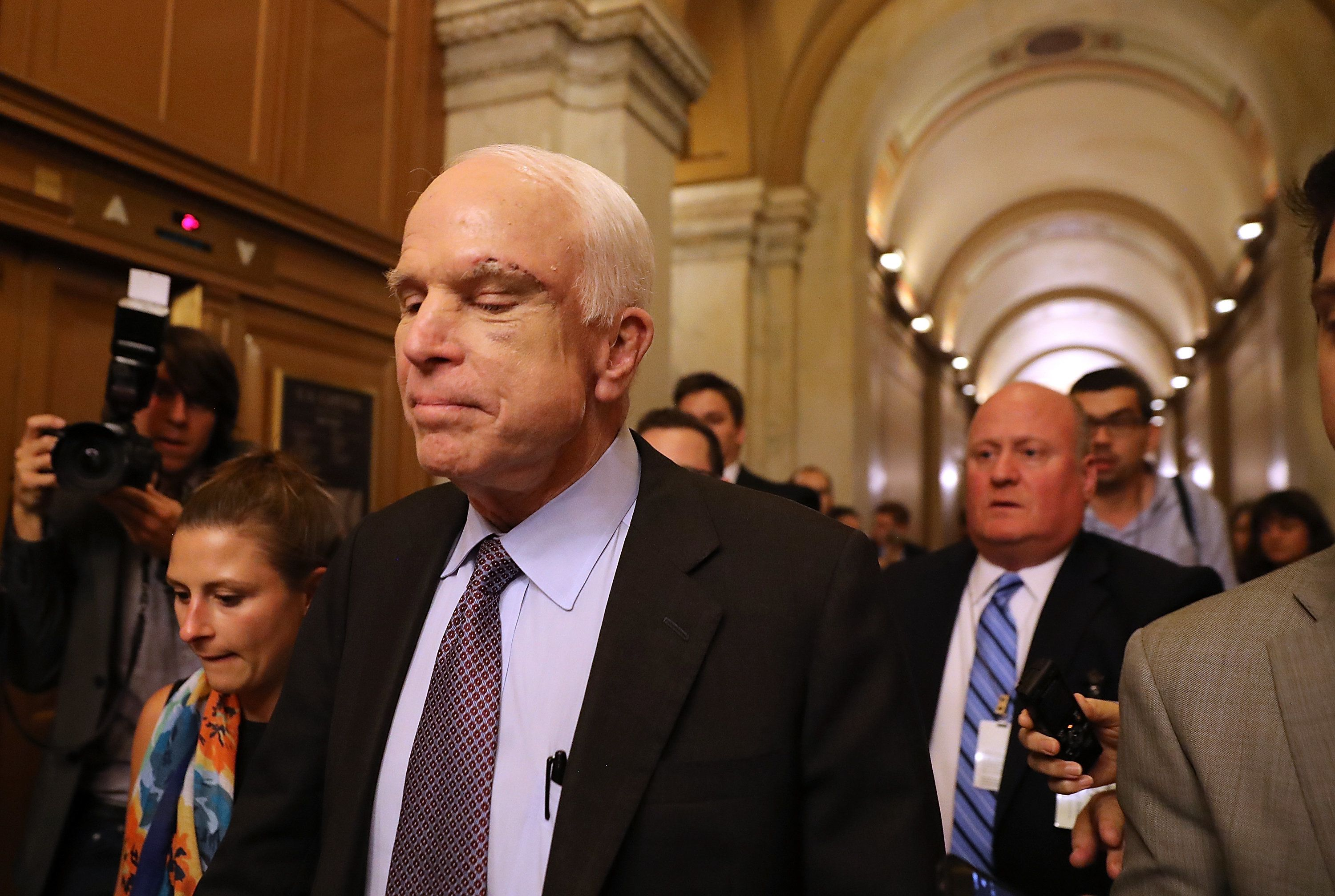 The Moment US Senators Gasp And Cheer As John McCain Votes Against Obamacare Repeal