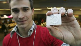 NEW YORK - NOVEMBER 03:  Brandon Schoderbek displays the new iPod shuffle, which went on sale today, in the Apple Store Fifth Avenue November 3, 2006 in New York City. The device costs $79 and contains one gigabyte of flash memory holding up to 240 songs.  (Photo by Mario Tama/Getty Images)