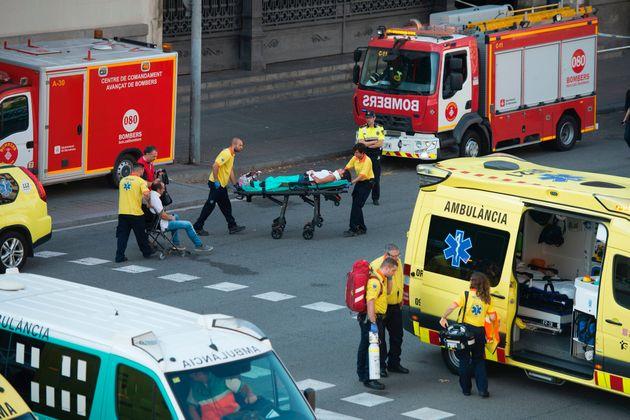 Medics rush injured passengers to waiting